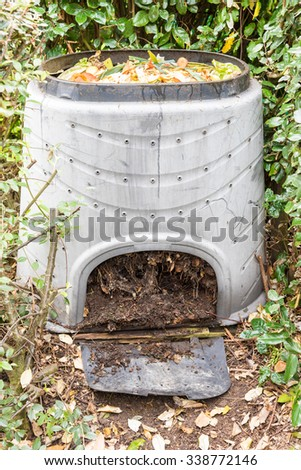Composting the Kitchen Waste in a plastic compost bin - stock photo