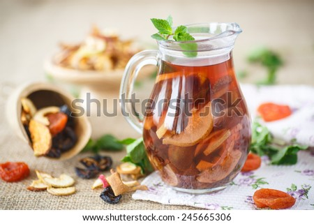 compote of dried fruits in a carafe on a table - stock photo