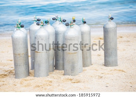 Compressed air tanks prepared for diving trip - stock photo