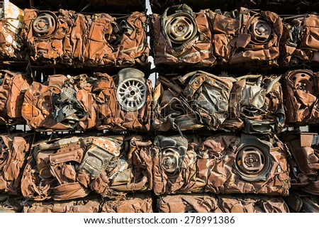 Compressed crushed cars. - stock photo