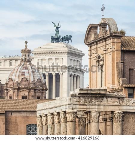 Compressed perspective of Roman landmarks. Ruins of the Roman Forum, Basilica di Santa Maria in Ara coeli, Mamertine Prison, Curia Iulia and Terrazza delle Quadrighe in Rome, Italy. - stock photo