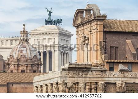 Compressed perspective of Roman lendmarks. Ruins of the Roman Forum, Basilica di Santa Maria in Ara coeli, Mamertine Prison, Curia Iulia and Terrazza delle Quadrighe in Rome, Italy. - stock photo