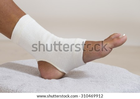 Compression stabilizer ankle. Foot injury, compression bandage - stock photo