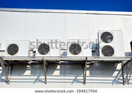 compressor of air condition set up on the building - stock photo
