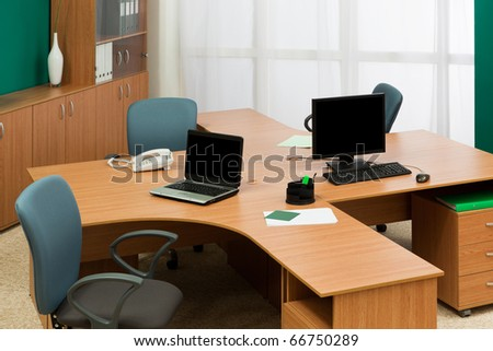 computer and laptop on a desk at modern office