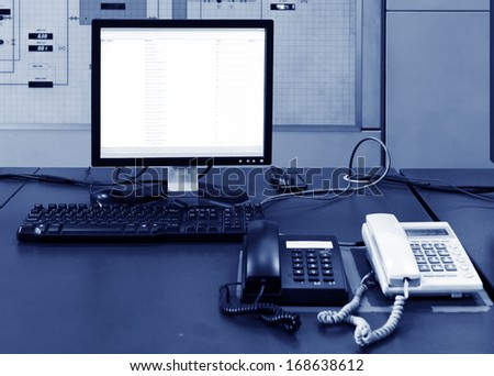 Computer and phone on the table in the lab - stock photo