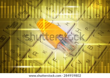 Computer cable on keyboard in abstract yellow background with numbers