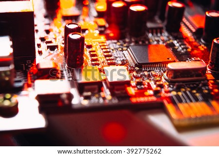 computer capacitors on the motherboard  red background - stock photo