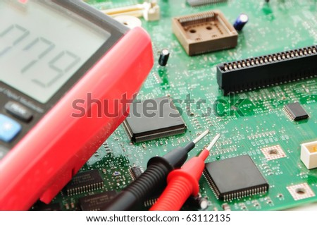 Computer circuit board and testing equipment - stock photo