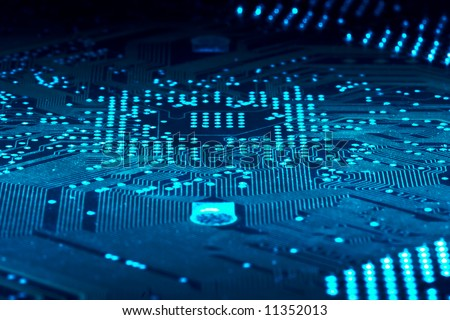 Computer circuit board in blue.  Shallow DOF across.  Part of a series. - stock photo