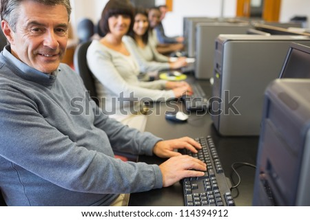 Computer class working happily in college