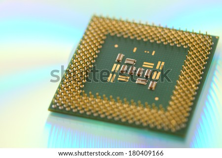 Computer CPU processor chip on green reflective background - stock photo