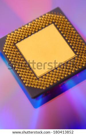 Computer cpu processor chip on purple dvd background - stock photo