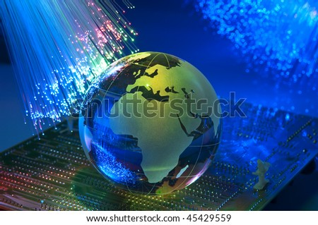 computer data concept with earth globe against fiber optic background more in my portfolio - stock photo
