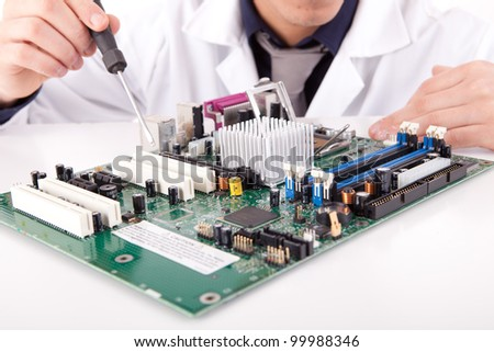 Computer engineer working on an old motherboard - stock photo