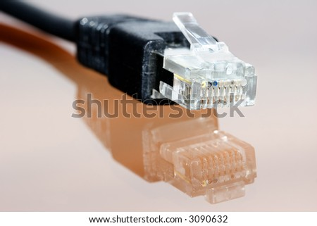 computer ethernet cable on neutral background with reflection - stock photo