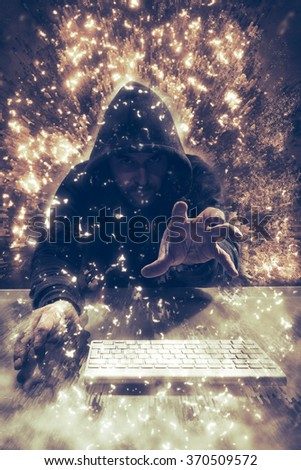 Computer hacker with hood, reaching out his hand to grab content or password, security breach or phishing, hacking concept. Composing with dynamic background.