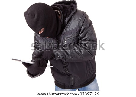 Computer hacker with white laptop - stock photo