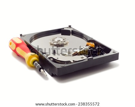 Computer hard disk drive isolated on white with a screwdriver - stock photo