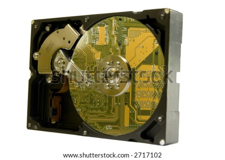 Computer hard drive exposed on a white background.  Reflection of computer motherboard on the platter.