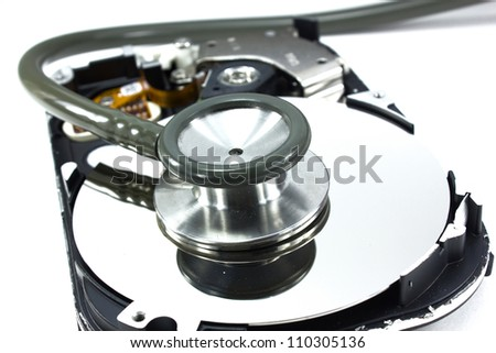 Computer hdd and hand with stethoscope - technology background - stock photo