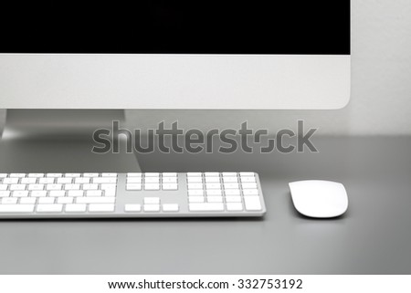 computer in the office close up, depth of field - stock photo