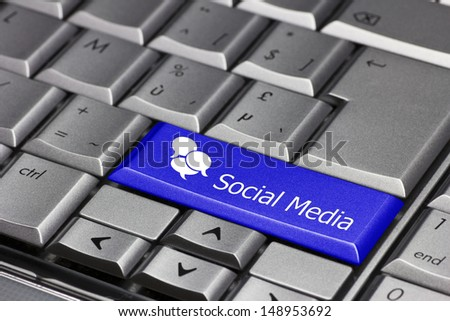 Computer key. Blue key with 3 speech balloons and the word social media. - stock photo