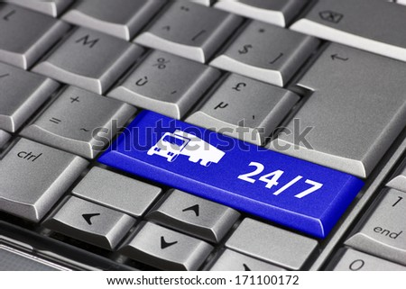 Computer Key blue - 24/7 with truck symbol - stock photo