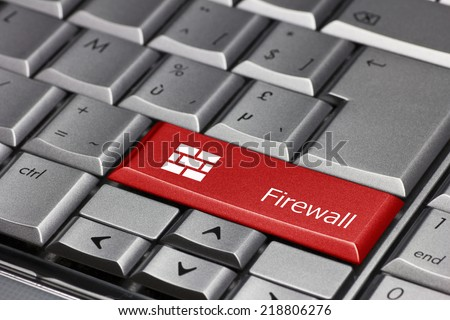 Computer key - Firewall with wall of bricks - stock photo