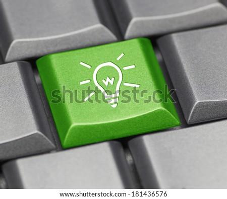 Computer key green - light bulb - stock photo