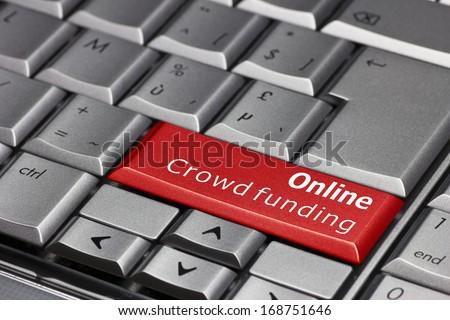 Computer key - Online Crowd funding  - stock photo