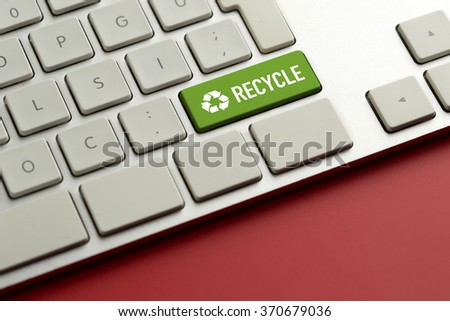 Computer key showing the word RECYCLE - stock photo