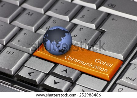 Computer key with globe showing Asia and Oceania - Global Communication - stock photo