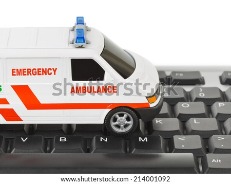 Computer keyboard and medical car - technology background - stock photo