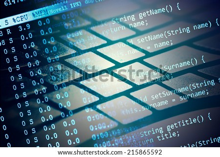 Computer keyboard and program data. Small depth of field.  - stock photo