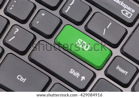 "Computer keyboard closeup with ""SEO"" text on green enter key"