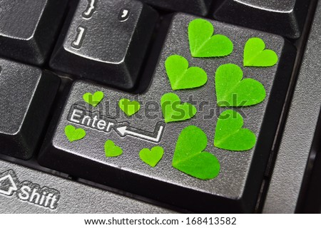 computer keyboard covered with green heart shape leaves