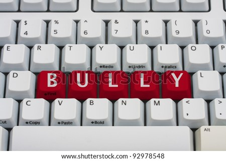 Computer keyboard key displaying word bully, Bullying on the Internet - stock photo