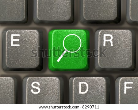 Computer keyboard, key with magnifier, close-up - stock photo