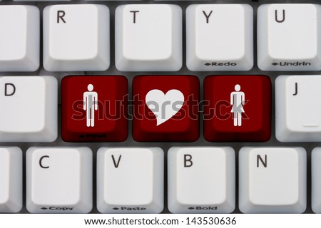 Computer keyboard keys with symbols of man and woman and a heart, Internet Dating - stock photo