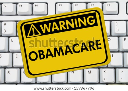 Computer keyboard keys with warning sign with words Affordable Healthcare, Obamacare - stock photo