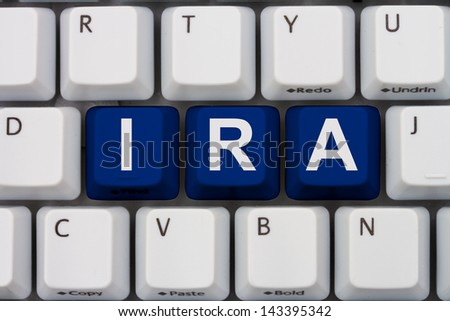 Computer keyboard keys with word IRA, Online Investments - stock photo