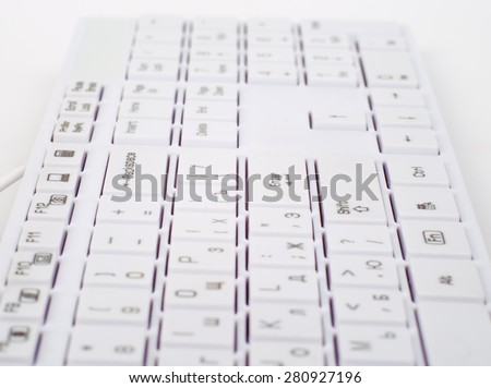 Computer keyboard on isolated white background, side view - stock photo