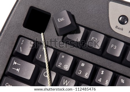 Computer keyboard with a rope coming out of the Esc key. - stock photo