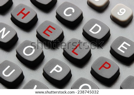 Computer keyboard with an help red text - stock photo