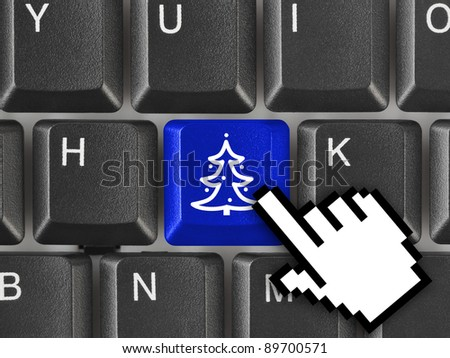 Computer keyboard with Christmas tree key - holiday concept - stock photo
