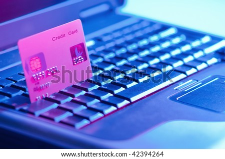 Computer keyboard with credit card - gelled lighting