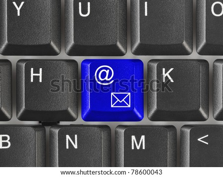 Computer keyboard with e-mail key - internet concept - stock photo