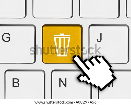Computer keyboard with garbage key - technology concept - stock photo