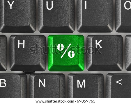 Computer keyboard with percent key - business background - stock photo